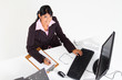 overhead view of young businesswoman in office