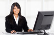beautiful young hispanic businesswoman working in office