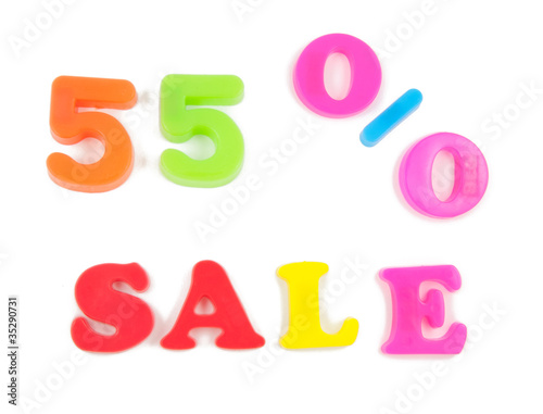 55% sale written in fridge magnets on white