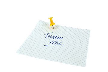 Paper note with handwritten THANK YOU words.