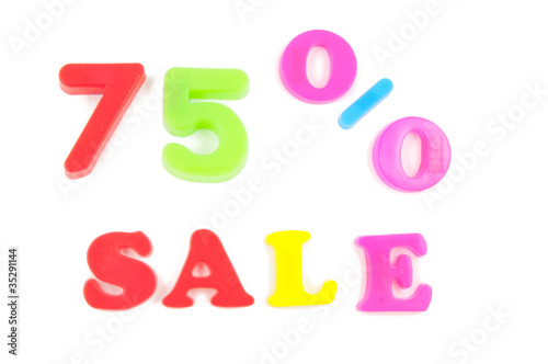 75% sale written in fridge magnets on white