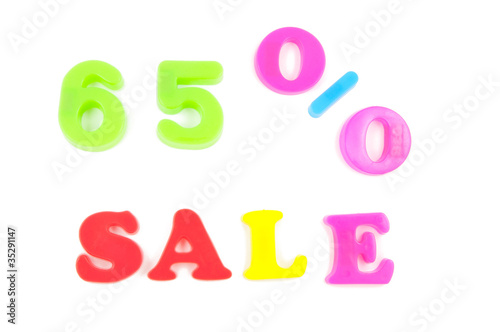 65% sale written in fridge magnets on white
