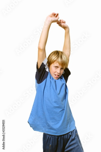 Boy with hands raised in the exercise