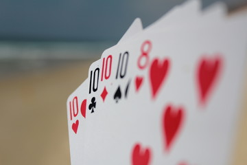 Poker hand - Four of a kind, with beach background