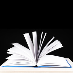 open book on a black background