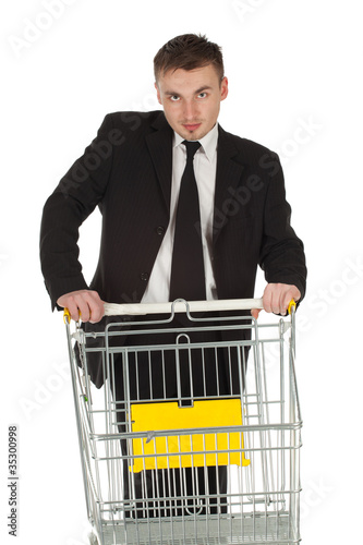 businessman in black suit and shopping cart