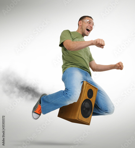 Unreal flying man on a speaker and smoke
