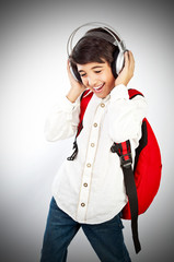 Pretty teen boy enjoying music