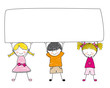 Niños sujetando un cartel