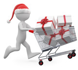 Man with Santa hat pushing a shopping cart full of gifts