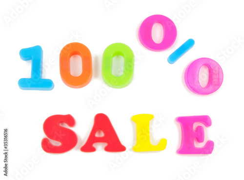 100% sale written in fridge magnets on white