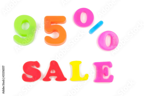 95% sale written in fridge magnets on white