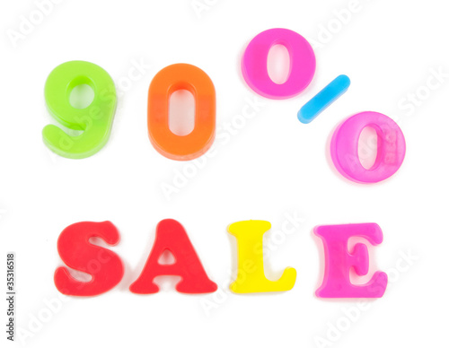 90% sale written in fridge magnets on white