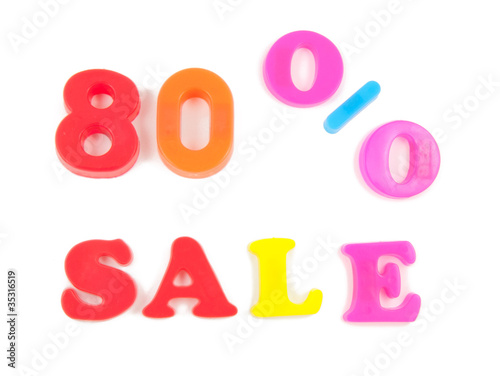 80% sale written in fridge magnets on white