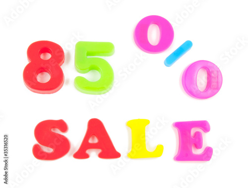85% sale written in fridge magnets on white