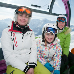 Ski vacation - family in cable car
