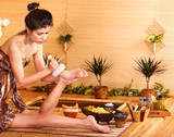Fototapety Woman getting foot massage in bamboo spa.