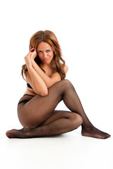 Cute young female sat on floor