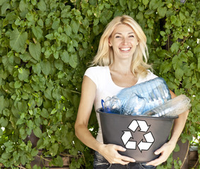 Young woman with recycling box. Copy space