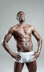 Good looking muscular man laughing