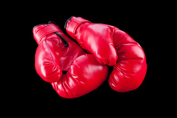 Red boxing gloves isolated on black