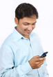 Indian Young Businessman Using a Cell Phone