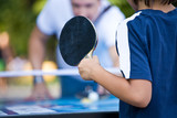 teenager plays Ping-Pong