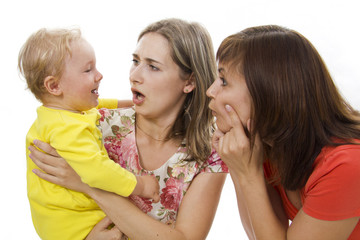 Mother and the aunt have fun together with the child