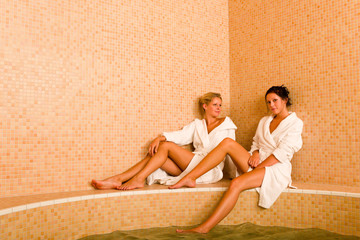 Relax spa pool two women sitting bathrobe
