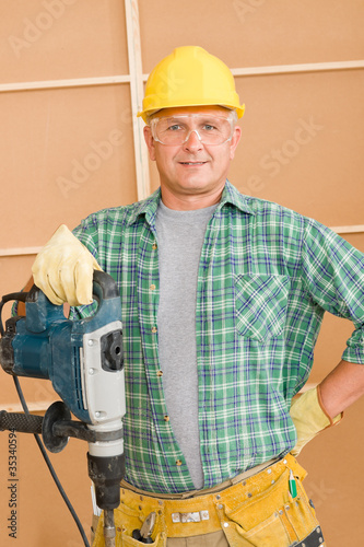Handyman home improvement working with jackhammer