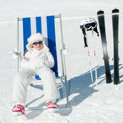 Ski vacation - little skier in winter resort