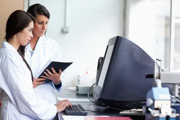 Female scientists using a monitor