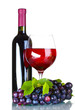 Ripe grapes, wine glass and bottle of wine isolated on white