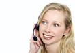 Frau telefoniert mit Headset