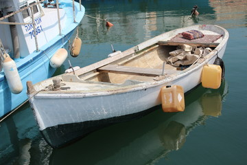Fishing boat tied to the pier, Jaffa Port, Israel