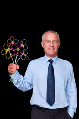 Businessman holding chalk drawn flowers