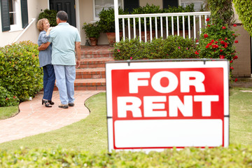 Senior Hispanic couple renting new home