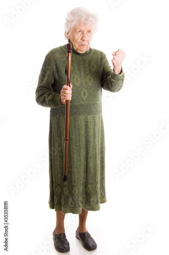 The elderly woman isolated on white