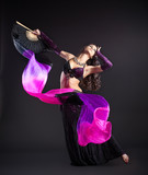 Fototapety beauty girl in arabic costume dance with fantail