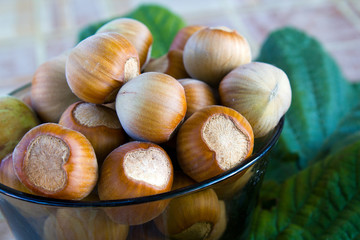 Hazelnuts in a brown glass bowl
