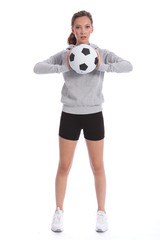 Tall teenage girl soccer player with sports ball
