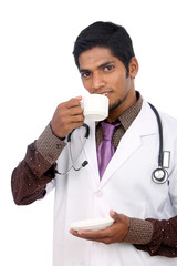 Indian young doctor drinking tea cup.