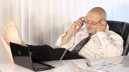Tired Businessman talking on the phone