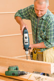 Handyman home improvement drilling wood