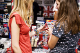 Two teenage girls looking at souvenirs of London