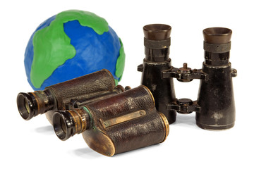 Two pair of binoculars and a globe