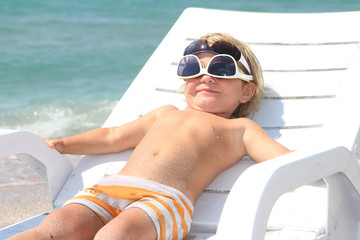 cute child relaxing on beach