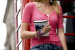 A teenage girl holding a London guidebook
