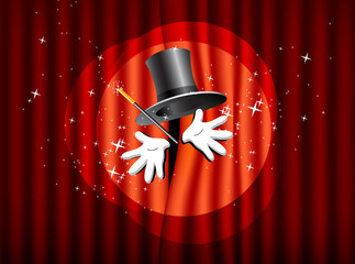 top hat, magic wand and hand on the background curtain