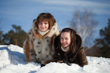 Girls lying on   snow